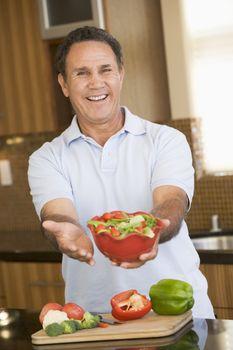 Man Presenting Salad