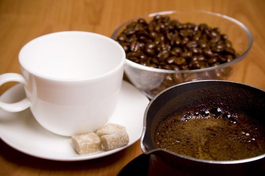 cup, coffee, sugar and beans in glass bowl