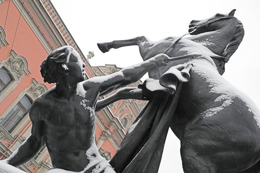 """Horse Monument - """"Taming of Horses"""" public ensemble in St. Petersburg, Russia, while snowing. This is a public (!) monument and no one can have a copyright of the sculpture."""
