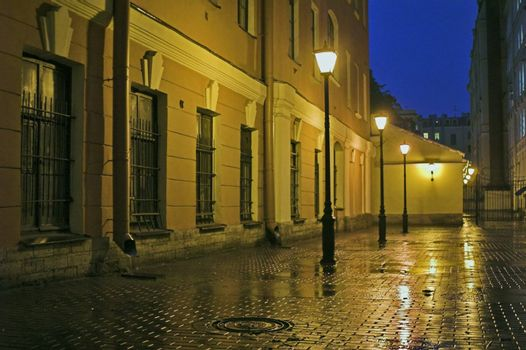Backyard with street lamps and stone pavement at evening in Saint Petersburg, Russia.