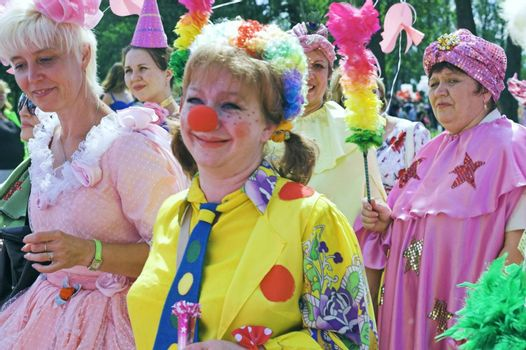 "ST PETERSBURG, RUSSIA-JUNE 28, 2008: People playing clowns at outdoor carnival party ""Life in Pink Festival"""