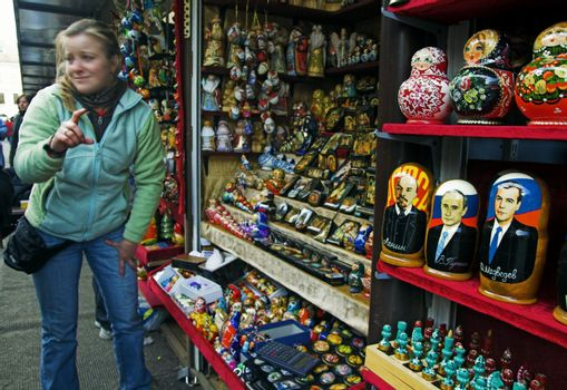 ST PETERSBURG, RUSSIA-MAY 5, 2008: Street vendor offering tourists to buy doll souvenirs depicting Lenin, Putin and Medvedev