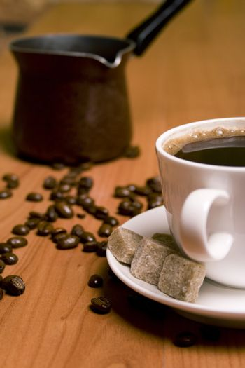 cup of coffee, sugar and beans