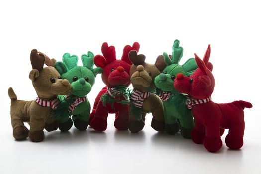 brown, green and red reindeer stuff toy, all close together for group shot