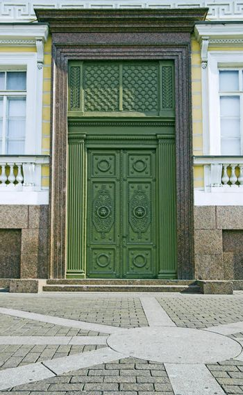 One of entrances to Building of General Army Staff at Palace Square in Saint Petersburg, Russia. Classicism-epoch style.