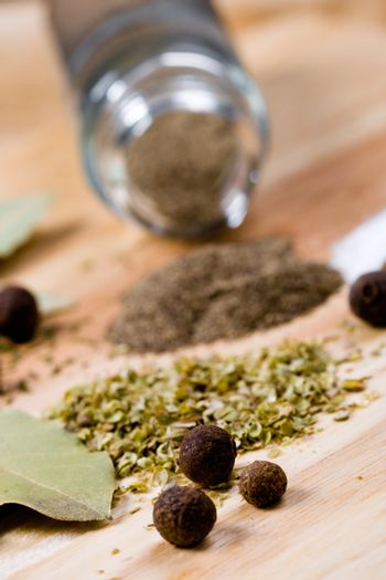 pepper, herbs and bay leaves
