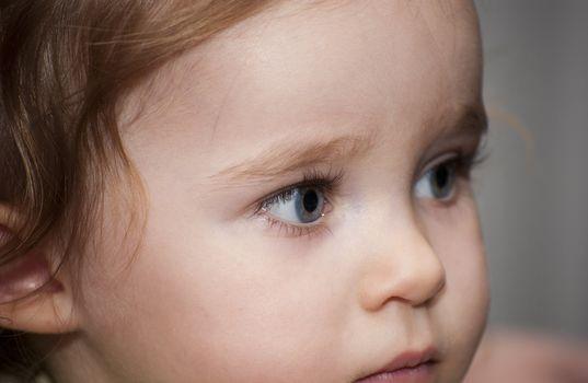Big blue eyed baby girl