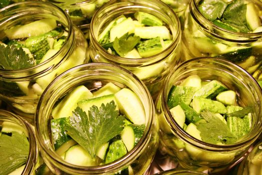 Glass jars of delicious preserved cucumbers