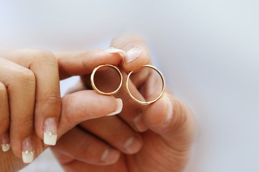 Two wedding ring in wedding couple hands