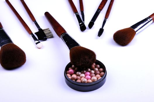 cosmetic powder and brushes