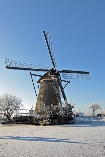 Windmill in wintertime at Kinderdijk in the Netherlands