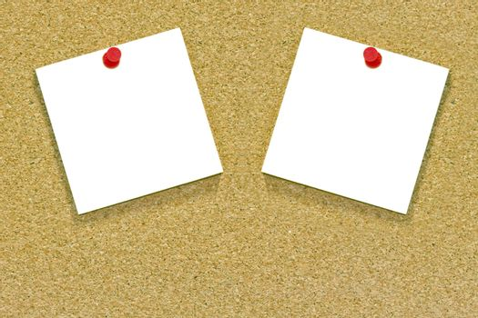 Two white notes on a cork noticeboard