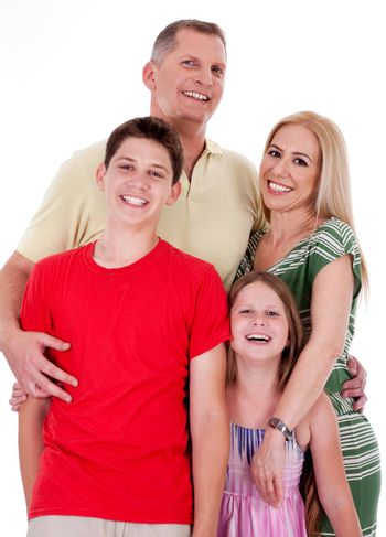 Full length portrait of a happy family isolated on white background