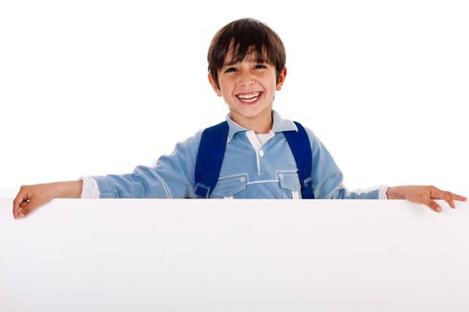 Charming kid holding blank board on isolated white background