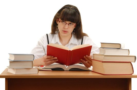 Teenage girl looking up and holding a book isolated on white