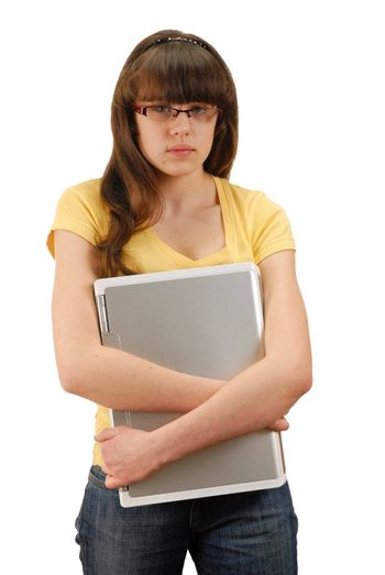 Teenage girl holding her computer, isolated on white