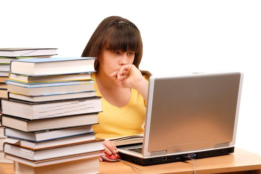 Teenage girl with her computer and books isolated on white