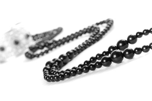 bracelet and black necklace