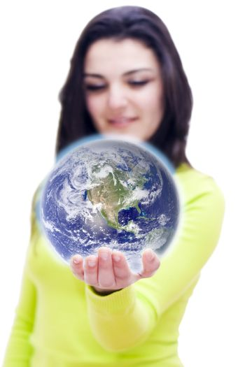 Conceptual image of the world in the hand of a woman with DOF
