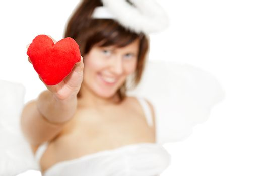 Young woman in angel's costume with red heart , isolated on white