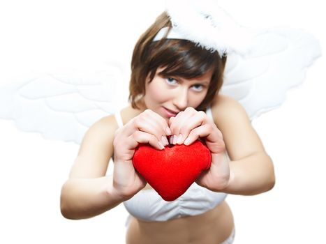 Young woman in angel's costume with red heart, isolated on white