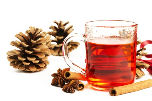 red tea cinnamon sticks star anise and conifer cone