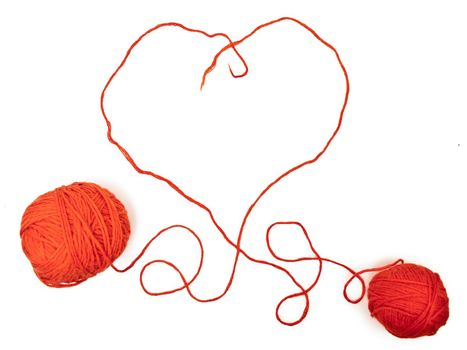 two red clews in heart form at the white