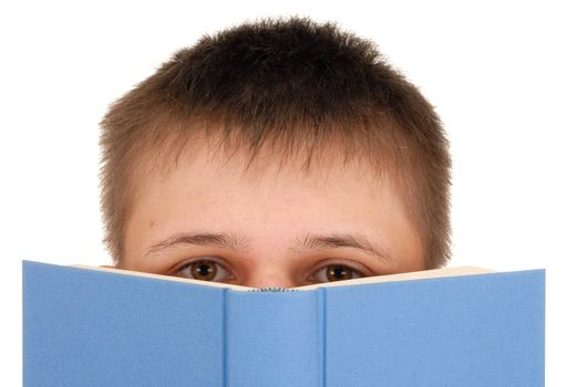 Teenager reading a book isolated on white