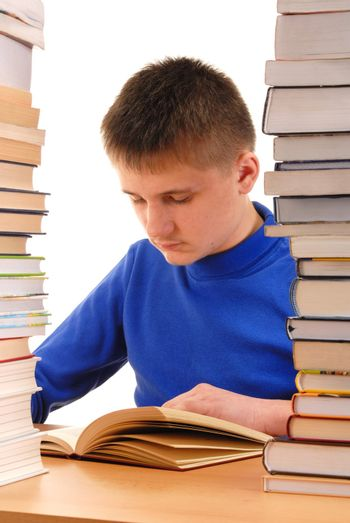 Teenager reading a book in a library