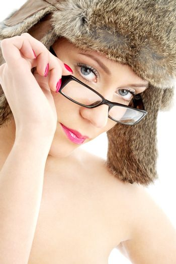 portrait of lovely beauty in winter hat and eyeglasses