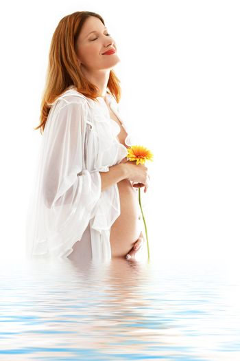 happy pregnant lady with flower in water