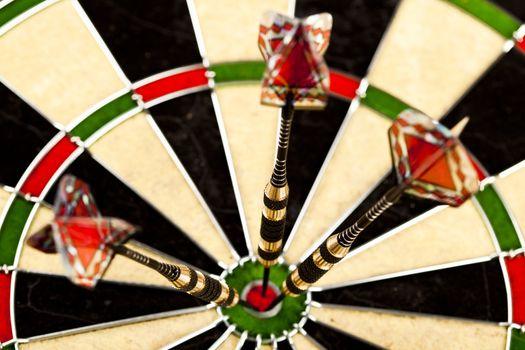 Dart on bulls eye target of dartboard