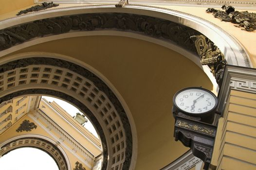Old-style  public clocks under the General Army Staff Building Arch in Saint Petersburg, Russia.