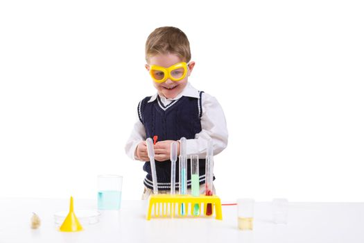 Young boy performing chemistry experiments with different liquids.