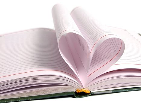 Pages of diary curved into heart