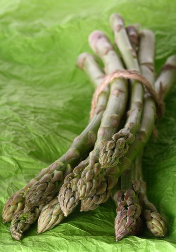 Bundle of asparagus tied together by rope