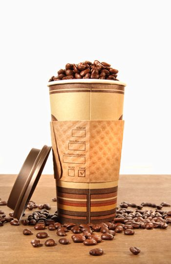 Disposable coffee cup with beans