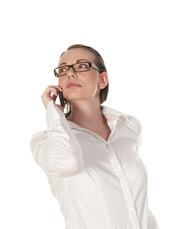 beautiful girl listening intensely to the telephone, seen against white background