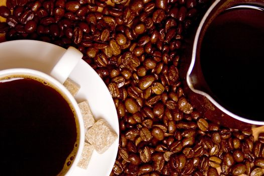 coffee, caffee-maker over beans background