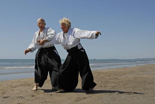 training of Aikido on the beach