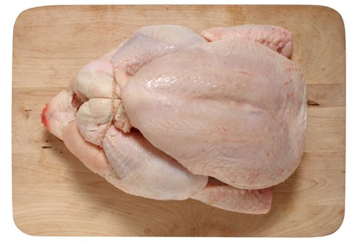 whole chicken on a wooden board