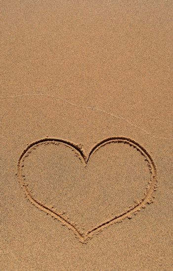 Heart drawing in sand, with copy-space