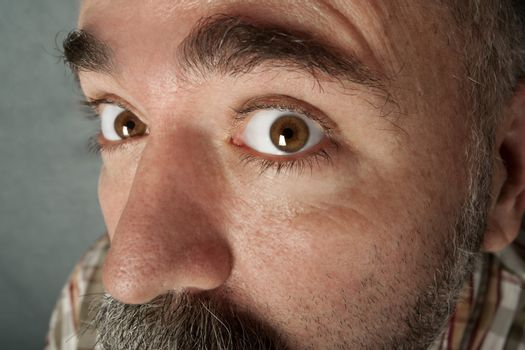 Extreme closeup of man in his 40s