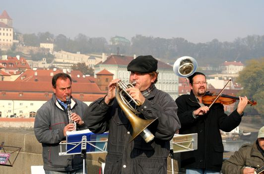 Street musical band playing classical music on Charles Bridge in Prague