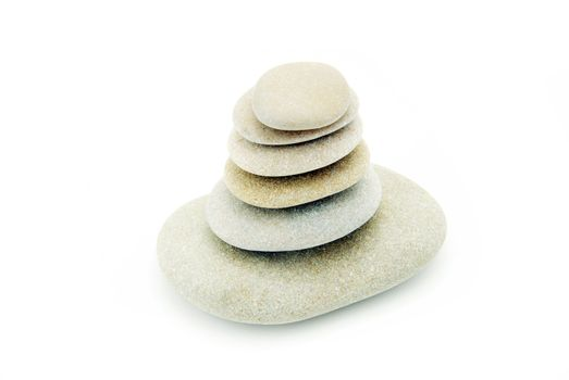 Stack of balanced stones on a white background