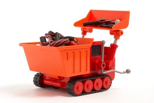 Toy digger loading liquorice candy