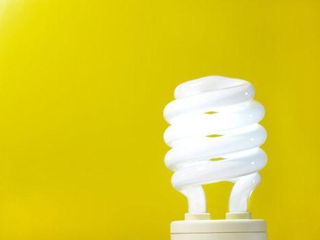 a yellow energy efficient light bulb.