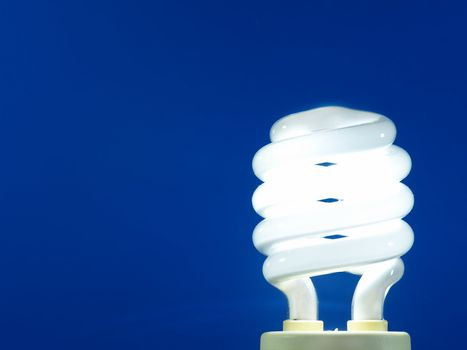 a blue energy efficient light bulb.