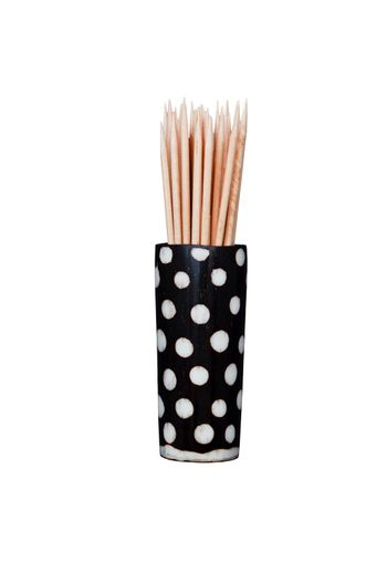 Wooden toothpicks in African spotted wooden holder