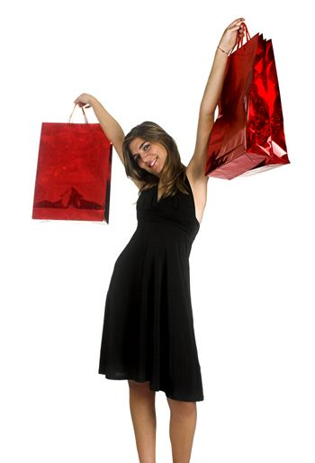 Happy woman isolated on a white background with presents.